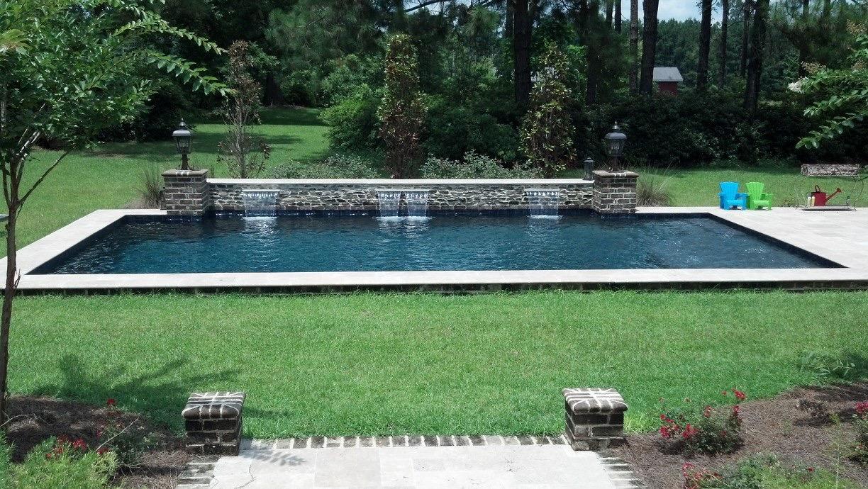 Concrete Pool | Brick Spill-over | Travertine Coping & Deck