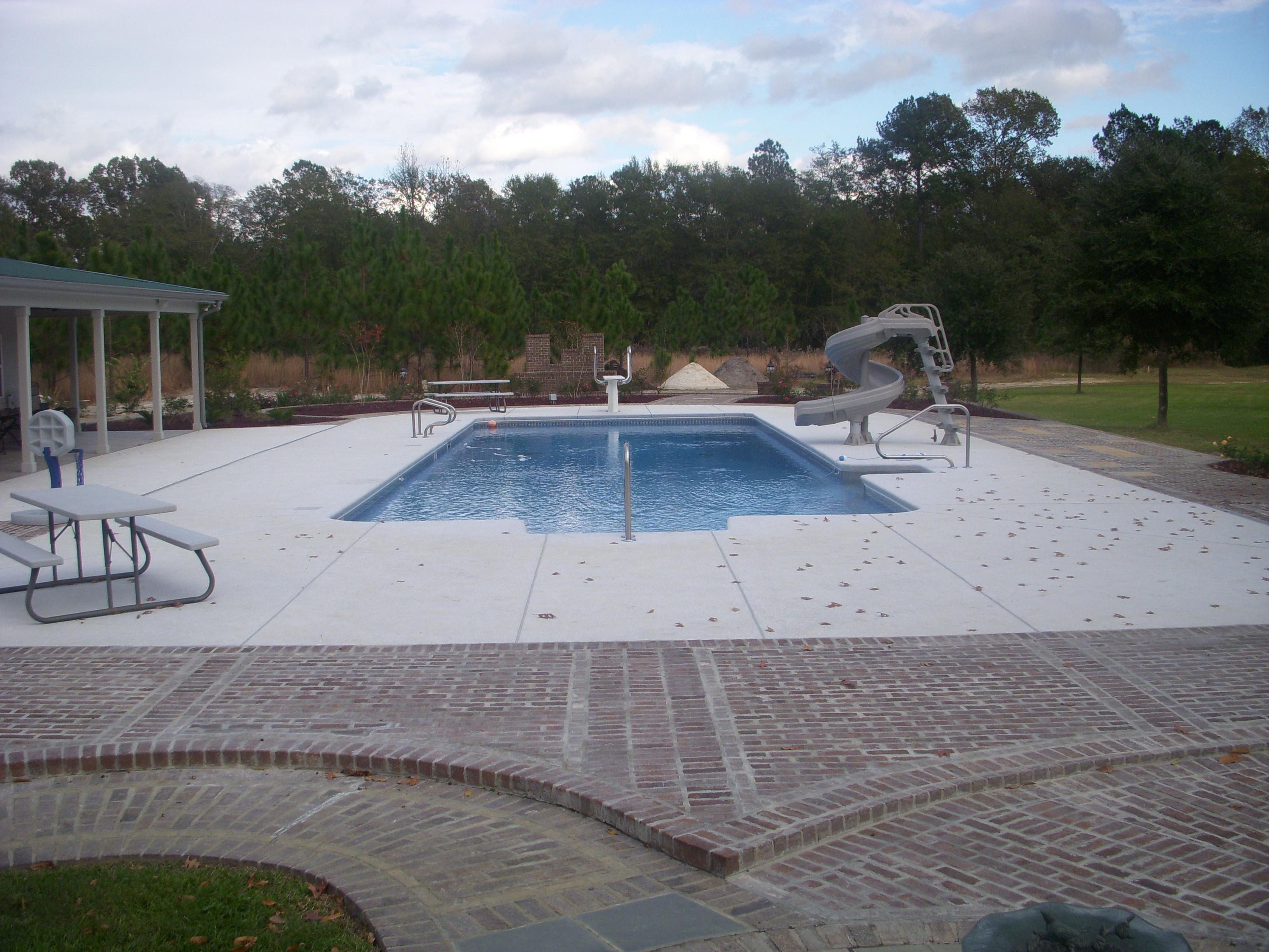 Vinyl Pool| Custom Pool Builder| Outdoor Living| Pool Features| Water Slide| Brick Walkway| Statesboro, Georgia| Thompson Pools